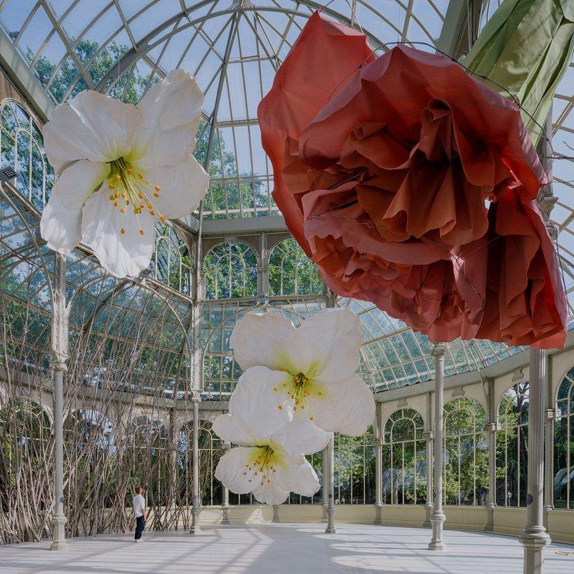 petrit halilaj turns madrids palacio de cristal into nest of giant flowers