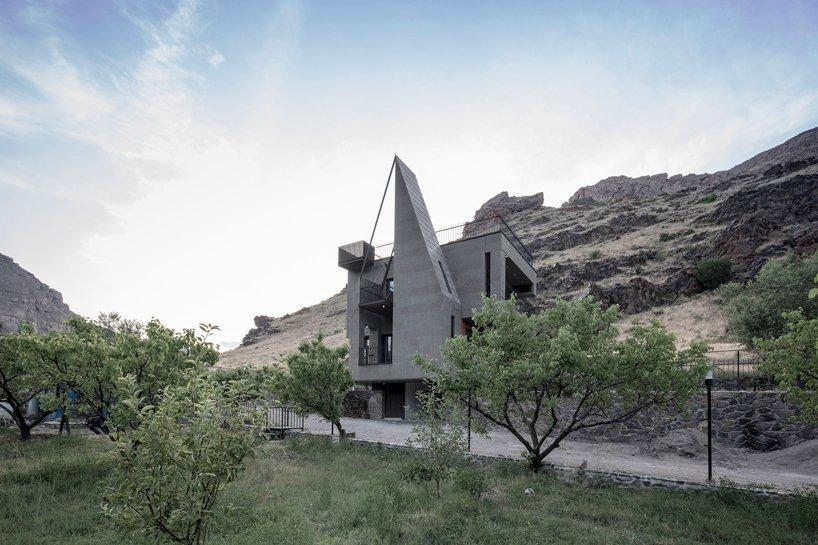 gray villa by white cube atelier draws from irans irregular rocks + mountains