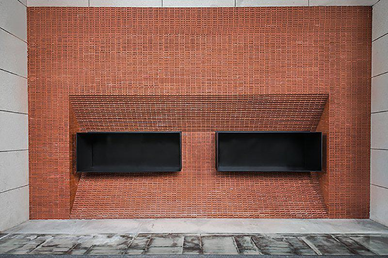 GEOM design stacks red bricks to build the façade of JPG coffee in china